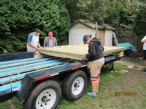 My cousin Alex and raising the subfloor up over the rods so that the holes could be drilled for the rods to fit through.