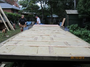 Jump to an insulated, re-levelled trailer and the first piece of plywood going in place.