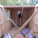 "The large loft is in place. I chose to go with cedar 4""x4"" for the collar ties for both lofts. The plans called for my flooring to go directly on the collar ties, but Stefan suggested that we go with 5/8"" plywood first and the put the flooring over top. I am very pleased with that decision as that plywood has taken a beating."