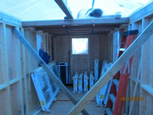 Me still asleep and stored below me are my windows which arrived Saturday morning stored safely under the loft.