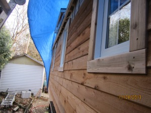 Look at that siding and the windows with trim.