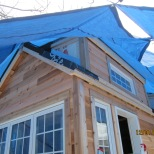 Another view of the dormer and large window siding.