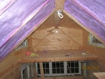 The small loft with all of its siding and ceiling installed. The purple is slowly disappearing.