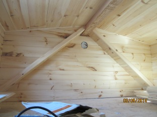 The trim in place along the top angled edge of the dormer. All of the trim has been custom made for Tiny Refuge using leftover siding.