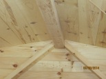 The trim where the ridge beam meets the wall in place in the main loft.