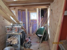The studs going in place for the wall between the kitchen and the bathroom.