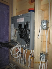 My breaker panel. I am bought a 60 amp panel and am swapping out the 60 amp breaker for a 50 amp breaker. The panel isn't completely wired yet, but it is getting there.