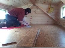 The cork floor being installed.