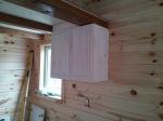 Stove side upper cabinet.