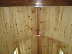 The ceiling with sealant and fire retardant.  At the top of the picture you can see one of the cedar beams that supports the loft, the beam has sealant on it, but no fire retardant.
